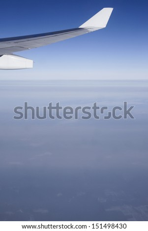 View to horizont and clouds from the plane during the flight