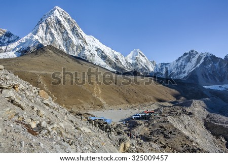 View to Kala Patthar peak and Gorak Shep village (Pumo Ri peak on background) - Everest region, Nepal, Himalayas
