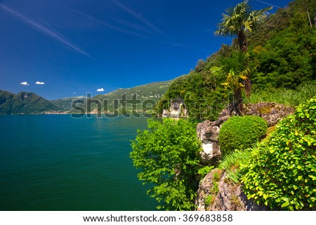 View to lake Como and Alpine mountains in Lombardy region, Italy