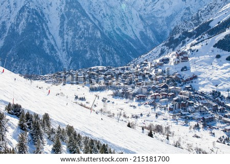 View to Les Deux Alps ski resort from mountain - stock photo