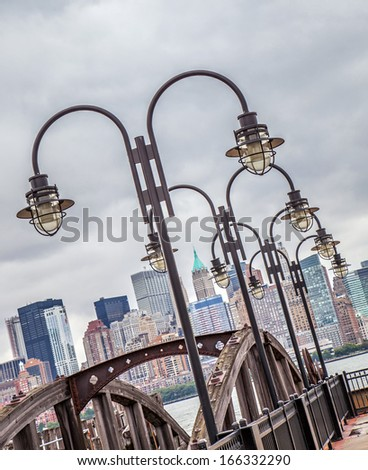 View to Manhattan from a pier with streetlights