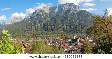 view to mittenwald village and karwendel mass, upper bavaria. - stock photo