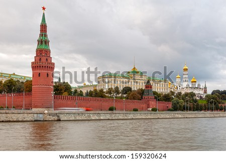 View to Moscow Kremlin from Sofiyskaya embankment over river under dark heavy clouds, Russian Federation