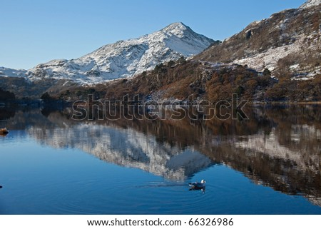 View to Mount Snowdon  in winter with snow and blue sky Snowdonia national Park