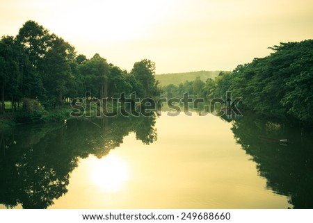 view to river with reflections - stock photo