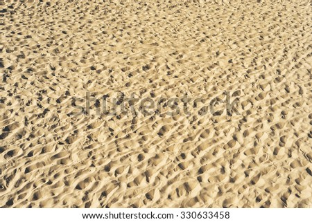 view to sand on beach as textured background - stock photo