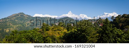 View to Sarangkot and the Annapurna Himalayan Range from a ridge above Pokhara, Nepal - stock photo