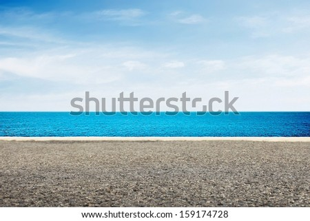 View to seascape from road - stock photo