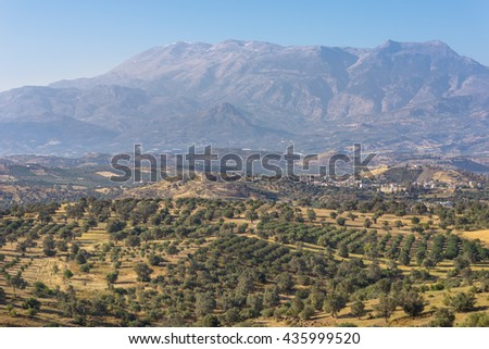 View to Sivas. Panorama landscape from south-central Crete. In the background the huge IDA Mountains with the Psiloritis as the highest elevation. In the foothills typical landscape with olive groves - stock photo