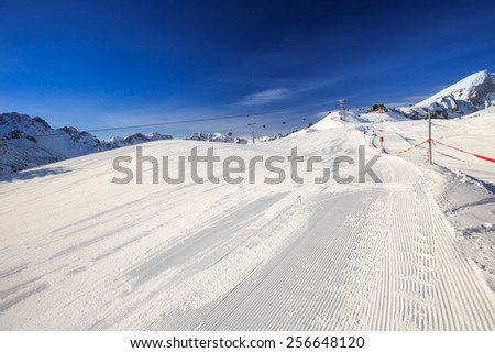 View to Ski slopes with the corduroy pattern and ski chairlifts on the top of Fellhorn Ski resort, Bavarian Alps, Oberstdorf, Germany - stock photo