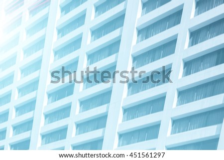 view to steel background of  high rise building skyscrapers in modern futuristic downtown. Business concept of successful industrial architecture