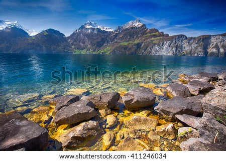 View to Swiss Alps and Lucerne lake from Sisikon village, Switzerland - stock photo
