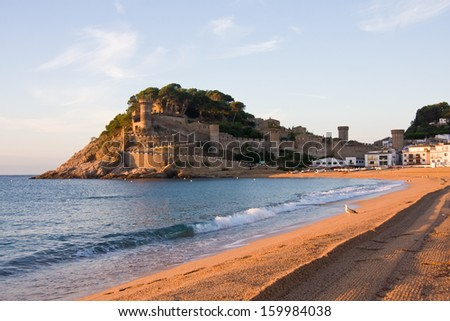 View to the beach and medieval castle in Tossa de Mar, Catalonia, Spain, Costa Brava, erly in the morning