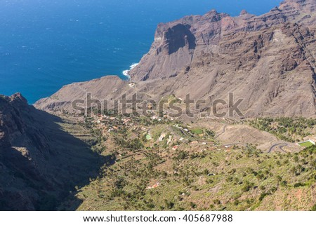 View to the canyon of Taguluche from the Mirador del Santo. Situated in the western part of Gomera near the village Arure and the Valle Gran Rey. The Mirador is named after the chapel Ermita del Santo - stock photo