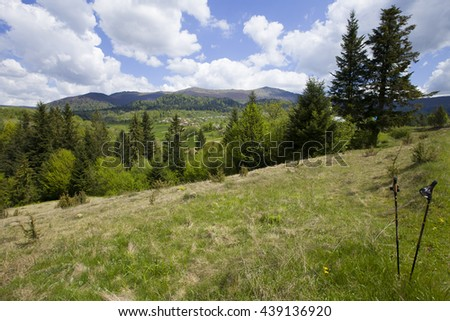 View to the Carpathian mountains with trekking poles
