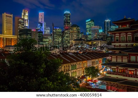 View to the impressive skyline of Singapore's central business district over Chinatown at the blue hour. - stock photo