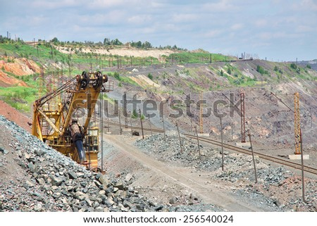 View to the iron ore opencast mining site - stock photo