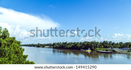 view to the river Missisippi with its wide river bed and a vessel in Louisiana - stock photo