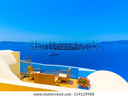 View to the sea and Volcano from Fira the capital of Santorini island in Greece - stock photo