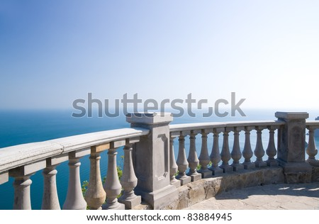 view to the sea from a balcony under clear blue sky