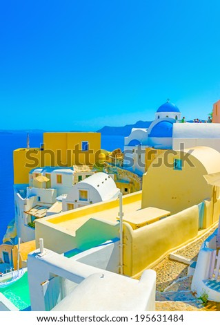 View to the sea from Oia the most beautiful village of Santorini island in Greece - stock photo