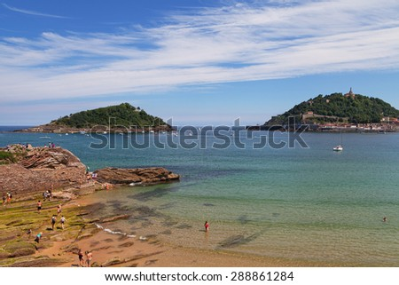 View to the Sebastian or Donostia coast in low tide. - stock photo