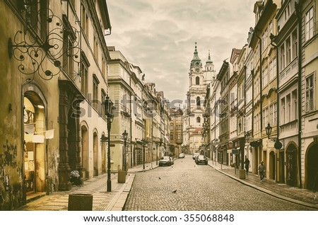 View to the street in the old center of Prague - the capital and largest city of the Czech Republic - vintage sepia retro travel background - stock photo