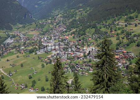 View to the swiss village of Grindelwald - stock photo