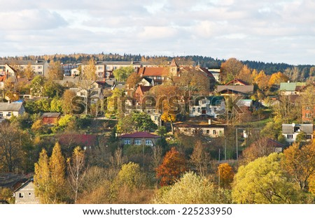 View to the town from hill in an autumn time. - stock photo