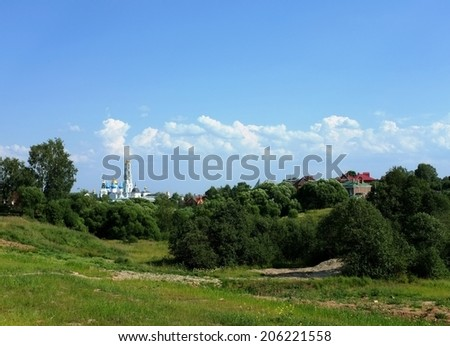 View to the Trinity Lavra of St. Sergius (Sergiev Posad) from countryside. That is the most important  spiritual center of the Russian Orthodox Church. Typical Russian landscape.  - stock photo