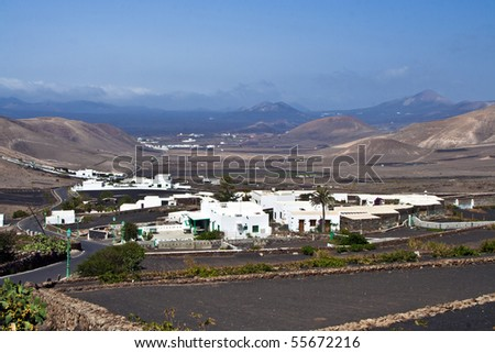 view to typical old houses in Yaiza in volcanic area, Lanzarote - stock photo