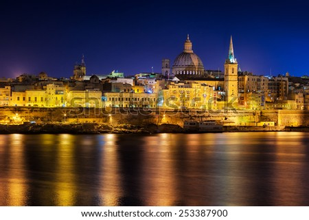 View to Valetta city historical buildings from Sliema district at night, Malta.