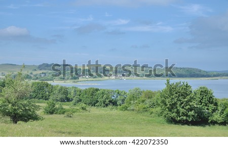 View to Village of Gross Zicker and Zickersche Alpen in Background  at Moenchgut Biosphere Reserve,Ruegen Island,baltic Sea,Mecklenburg western Pomerania,Germany - stock photo