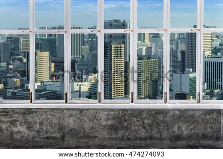 view Tokyo Skyline, Cityscape of Tokyo City, Japan  from white Aluminum window with glass frame and cement raw texture wall