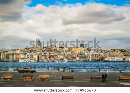 View towards Beyoglu and Karakoy in the city of Istanbul over the sea just next to the Galata brdge. Famous Galata tower or Galata Kulesi is rising above the skyline.