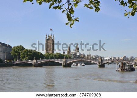 View towards city and Westminster along River Thames from South Bank with Lambeth Bridge. London. England