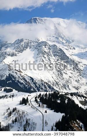 View towards Mont Blanc and Tramway du Mont-Blanc, Chamonix, Haute Alpes, France - stock photo