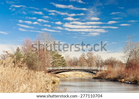View towards the Lafayette Bridge at St. Louis Forest Park on a sunny winter day with a few altocumulus clouds. - stock photo