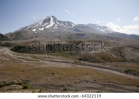 View towards the summit and crater of Mt. Saint Helens including the lava dome. After the 1980 eruption of this active volcano, there are still no trees although small plants are starting to grow. - stock photo