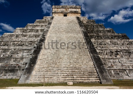 View up the stairs of El Castillo, the Mayan Pyramid to the god Kukulkan, the feathered serpent, at Chichen Itza, Yucatan, Mexico, on March 20, 2012, the day of the spring equinox 2012. - stock photo