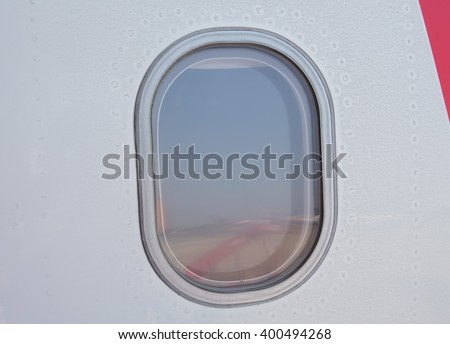 view window of airplane with sky behind - stock photo