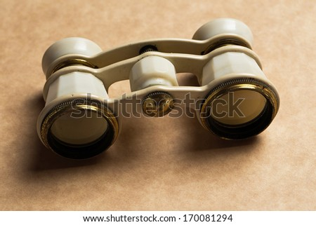View, zoom. White binoculars on the table - stock photo