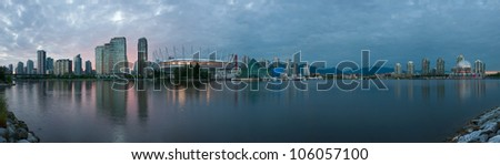 Viewed from False Creek, sunset over the Vancouver skyline - British Columbia, Canada. - stock photo