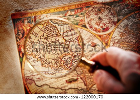 Viewed through a magnifying glass North America on the old map. - stock photo