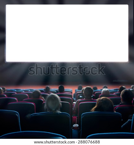viewers watch motion picture at movie theatre, long exposure - stock photo