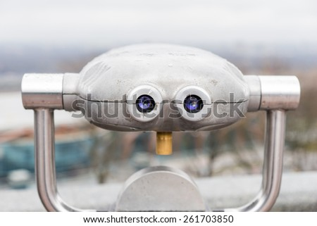 Viewing or observation telescope provided as a service to the public and tourists for sightseeing from an elevated view point , view from the back with binocular optics - stock photo