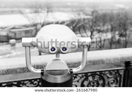 Viewing telescope for tourists mounted on an elevated viewpoint for sightseeing and distance vision - stock photo