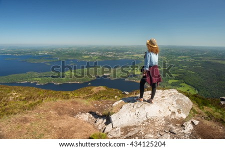 Viewing the green landscape of county Kerry from the top of the Torc mountain