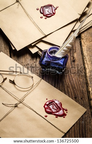 Viewing vintage mail with red sealant and glasses - stock photo