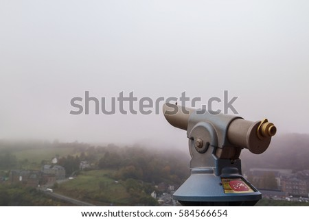 viewpoint telescope in a foggy day